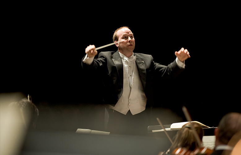 COS Conductor Michael Gesme, photo courtesy of Benjamin Edwards